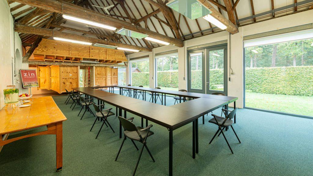 Atelier ruimte tuin u-vorm vergadering presentatie